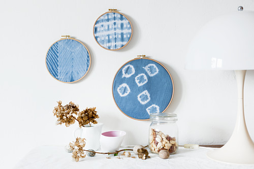 Hand-made wall decorations made from embroidery rings and old handkerchiefs hand-dyed using Shibori technique