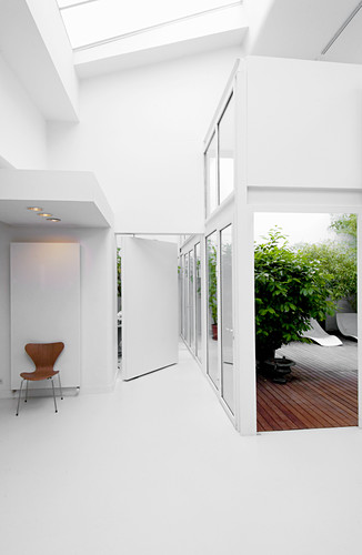 White, modern architect-designed house with interior conservatory