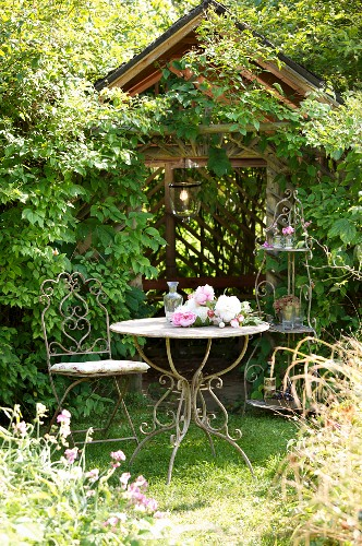 Romantic arbour and vintage garden furniture