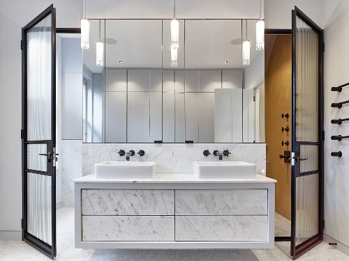 Marble washstand and wall-mounted mirrors in elegant bathroom
