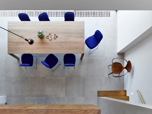 View down onto dining area with blue upholstered chairs