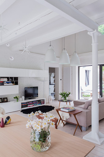 Bright living room with ceiling beams and modern TV cabinet