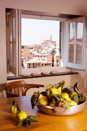 Pan holding quinces and view of city through window