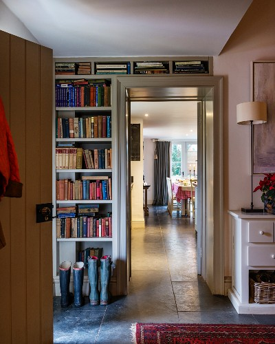 Fitted book shelves in foyer with view through to dining room