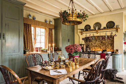 Old wooden table and chairs in English country-house kitchen