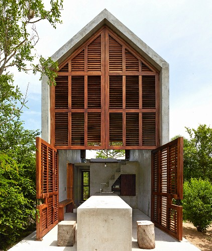 Modern architect-designed house made from wood and concrete amongst trees