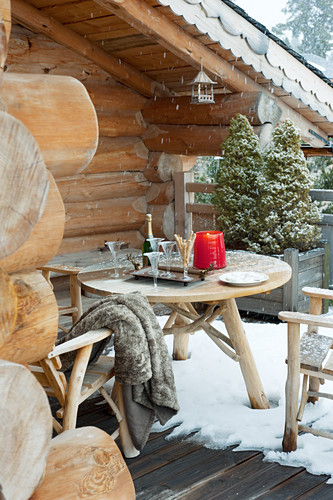 Champagne in seating area on snowy balcony