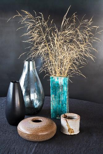 Dry grasses in seventies vases