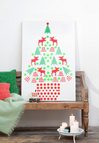 Stylised Christmas tree made from collage of cut-out silhouettes stuck on white panel