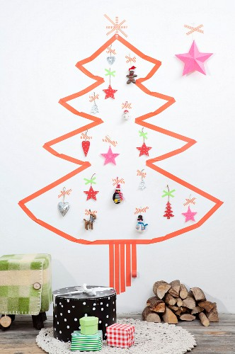Christmas tree made from washi tape and various decorations stuck on white wall
