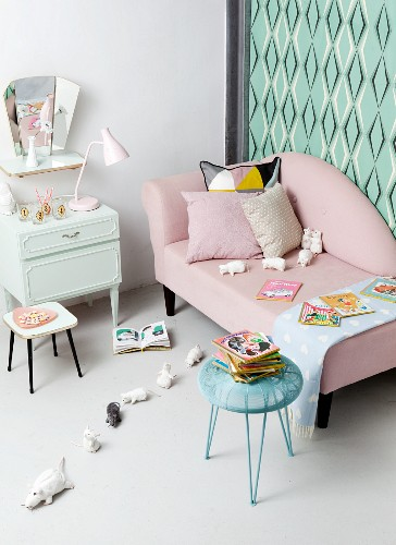 Retro ambiance, pastel shades, soft toys and picture books in child's bedroom