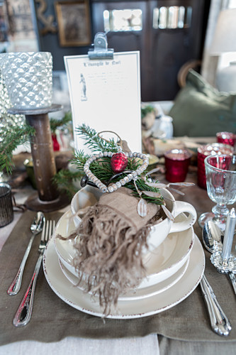 Christmas table lavishly set with many vintage-style decorations