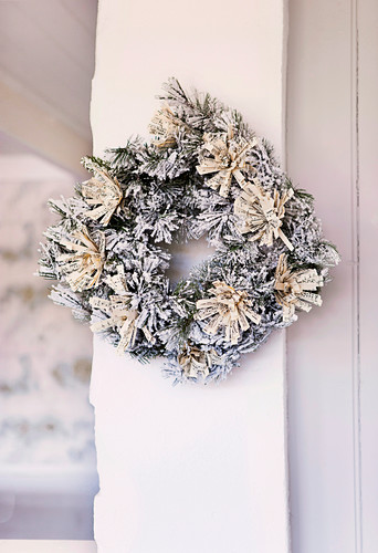 Christmas wreath with artificial snow and tassels made of sheet music