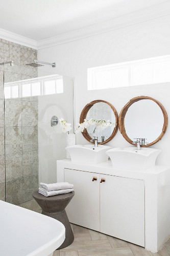 White and grey bathroom with modern countertop sinks