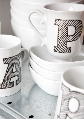 White cups with black shaded block letters