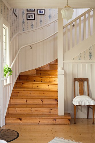 Wooden stairs in Scandinavian country-house-style foyer