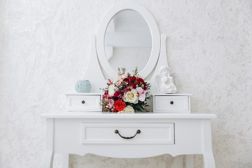 Bouquet of flowers on white dressing table