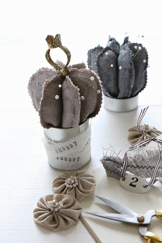 Hand-sewn cactus pin cushions made from grey fabric