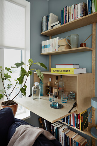 Drinks cabinet integrated into modern wooden shelving