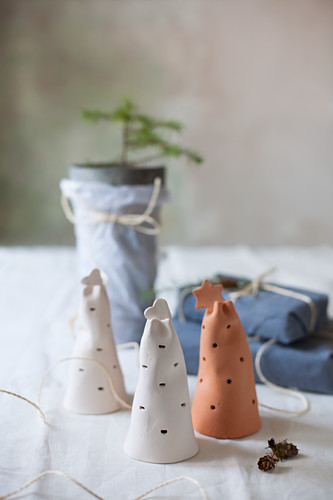 Perforated pottery bells and gifts wrapped in fabric