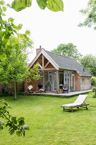 Lawn and large summerhouse with terrace in well-tended garden
