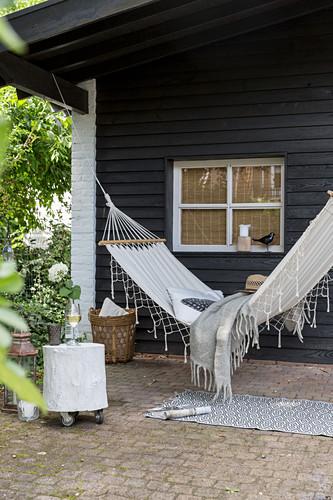 Hammock on veranda outside wooden house