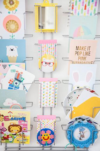 Postcard rack on wall