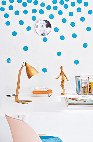A white wall decoration with blue dots
