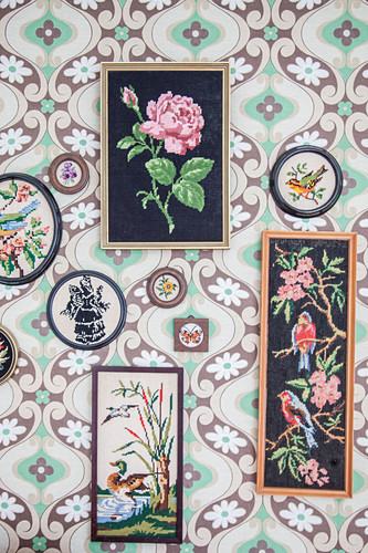 Framed tapestries on retro wallpaper