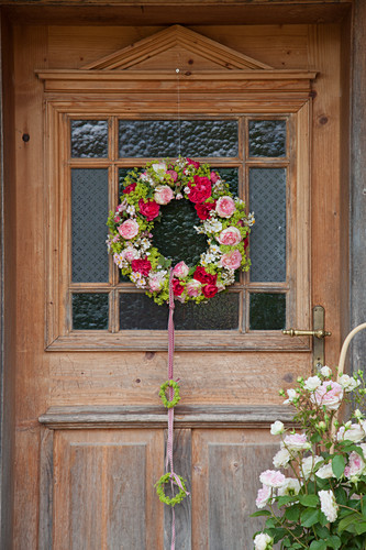 Wreath of roses and lady's mantle on front door