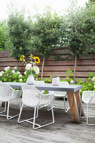 Table and designer chairs on terrace