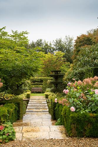 Steps leading to bench in garden (Les Jardins de Castillon, France)