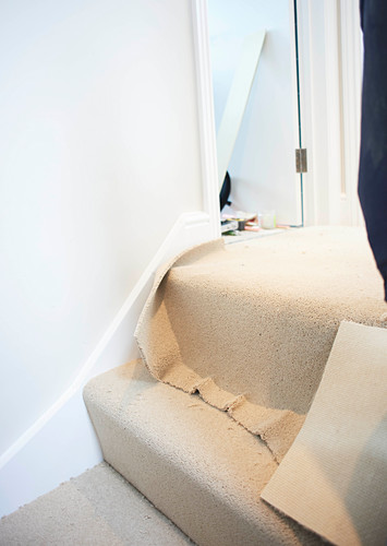 Laying new carpet on staircase