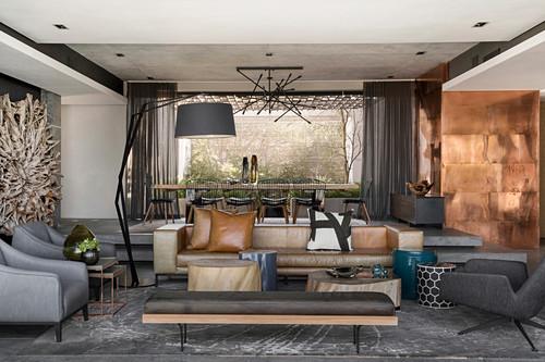 Luxurious, split-level interior in earthy tones
