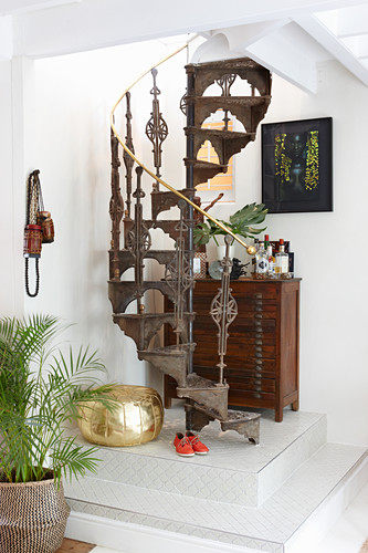 Old cast-iron spiral staircase on platform