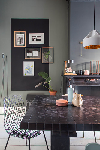 Dining table and classic chair in dining room with dark wall