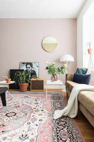 Sofa, side table, standard lamp, mirror and rug in bright living room