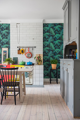 Accents of colour in kitchen with dining table and old dresser