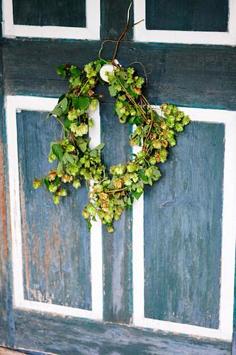 Wreath of hops on wooden door