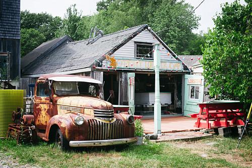 Old rusty truck outside American fishmongers