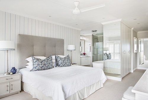 Large white bedroom with ensuite bathroom