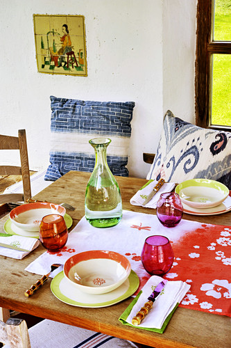 Table set with colourful crockery