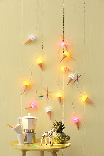 Summery ice-cream-cone fairy lights on yellow wall