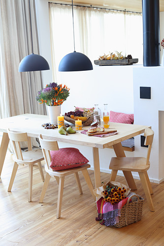 Dining room with wooden furniture in modern country-house style