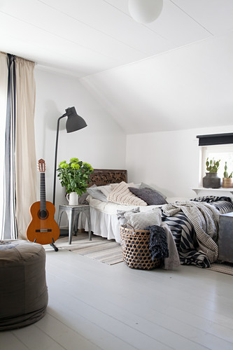Bohemian-style bedroom with sloping ceiling