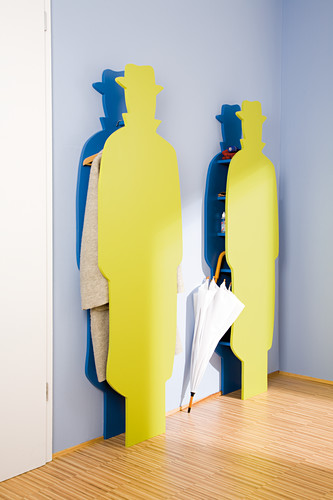 Colourful cloakroom stands in the shape of a man wearing a hat