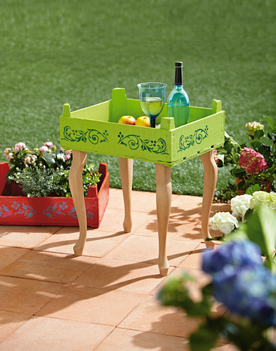 Side table made from painted fruit crate and table legs