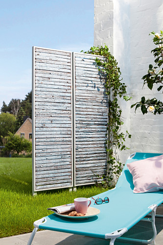 DIY screen made from bark panels in garden