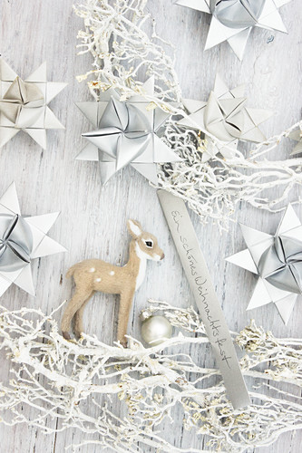 Wreath handmade from white twigs, origami stars and deer figurine