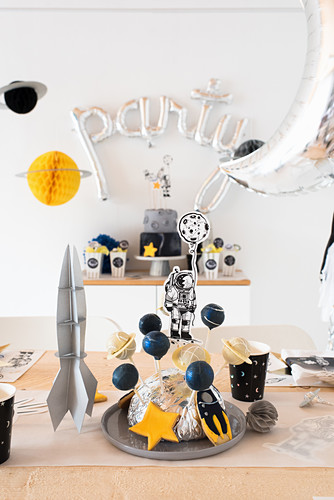 Space party: cake pops on table festively set for child's birthday party